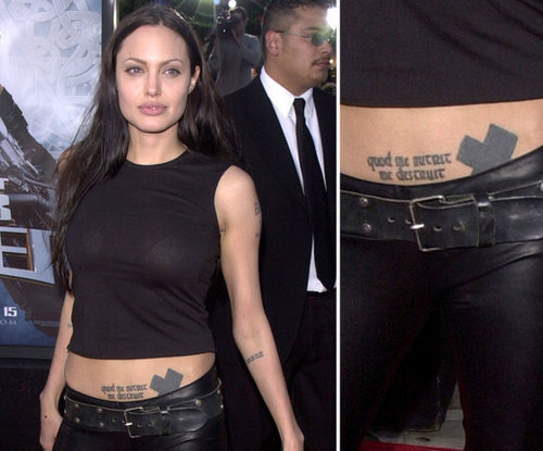 "Angelina Jolie got a dragon tattoo on her abdomen during a drunk night in Amsterdam, and later covered it up with a large black cross. She also has ab ink of the Latin words ""quod me nutrit me destruit,"" which means, ""what nourishes me, destroys me."""