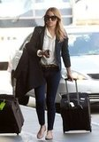 Lauren Conrad wore a dark blazer and denim for her flight.