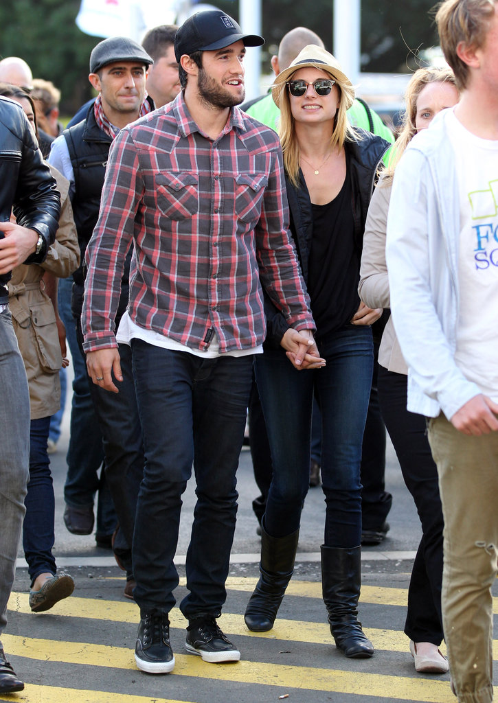 Emily VanCamp and Joshua Bowman held hands in Australia.