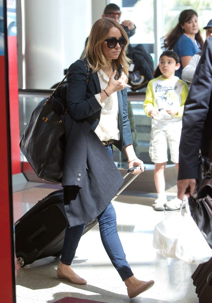 Lauren Conrad wore flats for her flight.