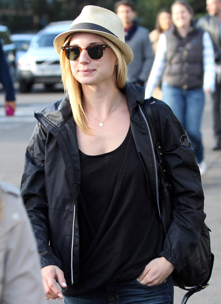 Emily VanCamp had on sunglasses and a hat.