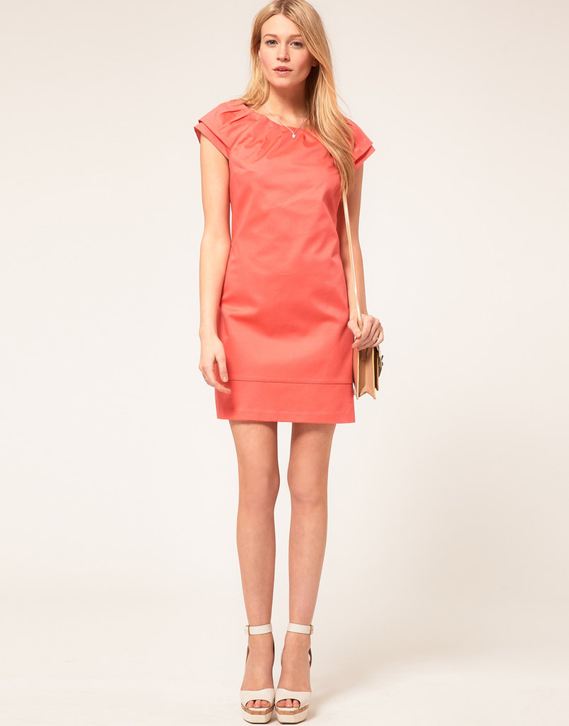 We love the coral hue (and subtle perforation) on this sweet minidress.  Oasis Double-Sleeve Perforated Dress ($76)