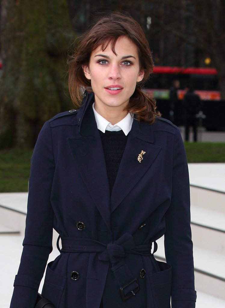 Alexa Chung pinned a whimsical creature on her navy coat during London Fashion Week.