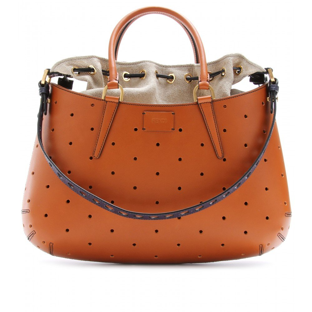 Channel cool-girl elegance with this cognac-colored tote.  Fendi Perforated Mixed-Media Shoulder Bag ($1,965)