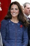 Kate Middleton added a pop of red to her Rebecca Taylor tweed suit via a shimmery crystal floral brooch