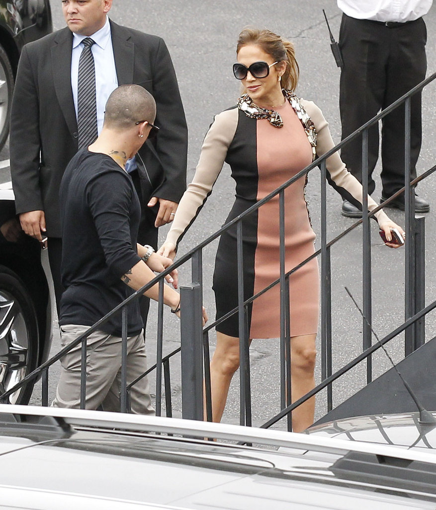 Jennifer Lopez and Casper Smart were hand in hand on their way to a press conference.