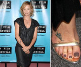 Charlize Theron sports a small flower on the top of her right foot.