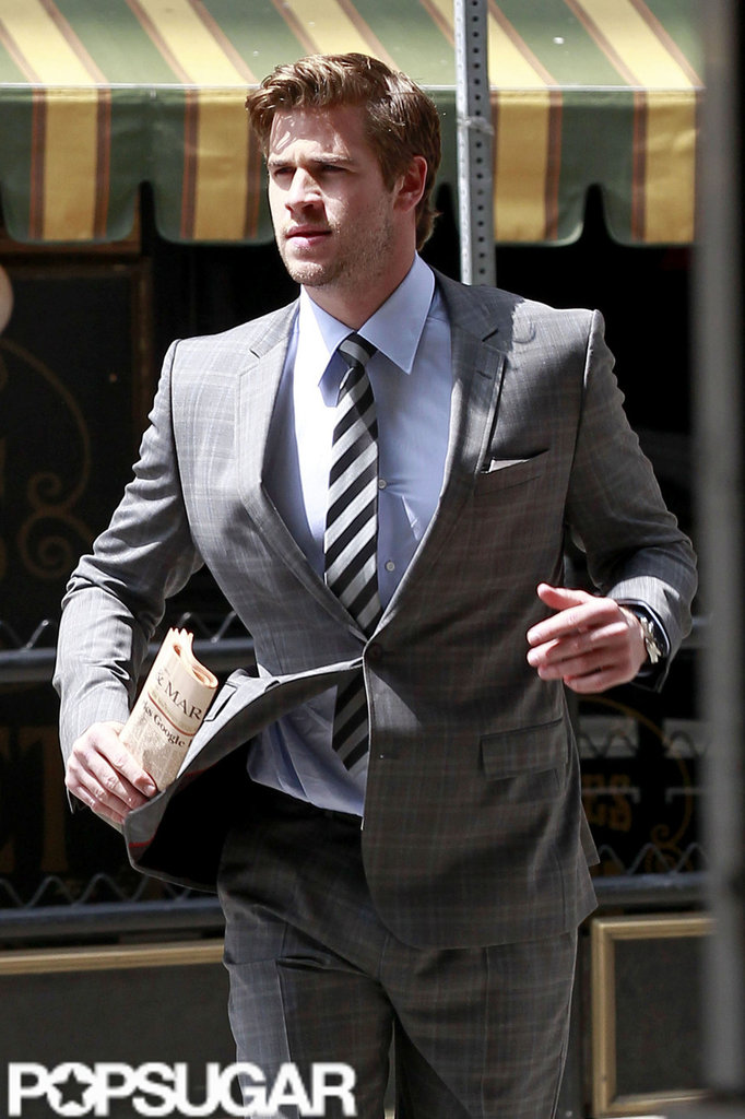 Liam Hemsworth was in action in a gray suit and striped tie for a Men's Health photo shoot in LA.