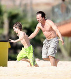 In December 2008, Christian Slater ran around on the beach with his son.