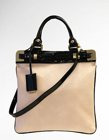 The two-tone combination of black patent leather and beige pebble leather makes this satchel an elegant option for everyday. Ivanka Trump Onyx Patent/Pebble Satchel ($150)