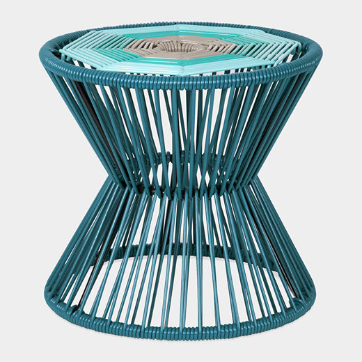 We love the merge of a traditional silhouette with modern materials and vibrant turquoise color in this Banqitos Stool ($145).
