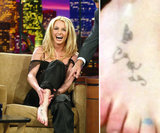 Britney Spears showed off her foot tattoos during an appearance on the Tonight Show with Jay Leno in November 2003.