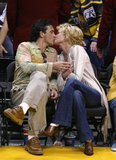 Antonio Banderas and Melanie Griffith kissed courtside at a Lakers game.