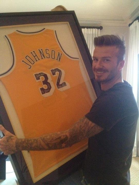 "David Beckham with the ""best birthday gift ever,"" a Magic Johnson jersey."