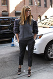During New York Fashion Week, Nina opted for brown Burberry buckled platform sandals with her fur-sleeved sweater.  6820263