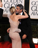 Drew Barrymore got a kiss from George Clooney at the January 2010 Golden Globes.