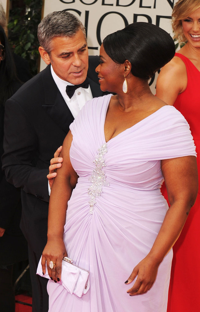 Octavia Spencer got some love from George Clooney on the Golden Globes red carpet in January 2012.