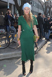 We love this pared down look on Anna outside of Emporio Armani during Fashion Week — especially the mix of the kelly green dress with the powder blue veiled beanie.