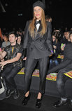 Looking chic in a menswear-inspired suit, chunky flatforms, and a veiled beanie, Anna Dello Russo posed at the Dsquared show.
