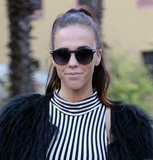 Instead of opting for retro-inspired round sunglasses, she wore a larger, contemporary version of the style.
