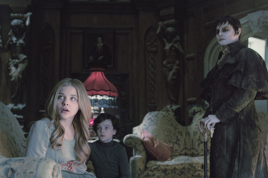 Gulliver McGrath as David Collins, Chloë Grace Moretz as Carolyn Stoddard, and Johnny Depp as Barnabas Collins in Dark Shadows.  Photo courtesy of Warner Bros.