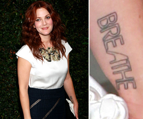 "Drew Barrymore has the word ""breathe"" tattooed on her inner left wrist."