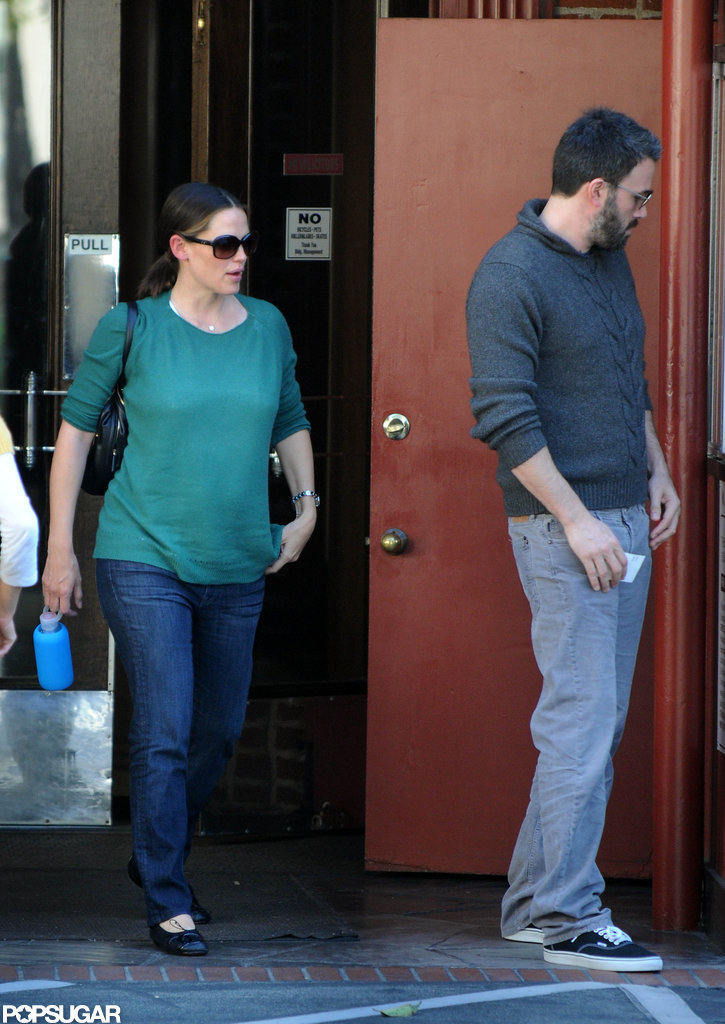 Jennifer Garner wore a green sweater while out running errands with husband Ben Affleck in LA.