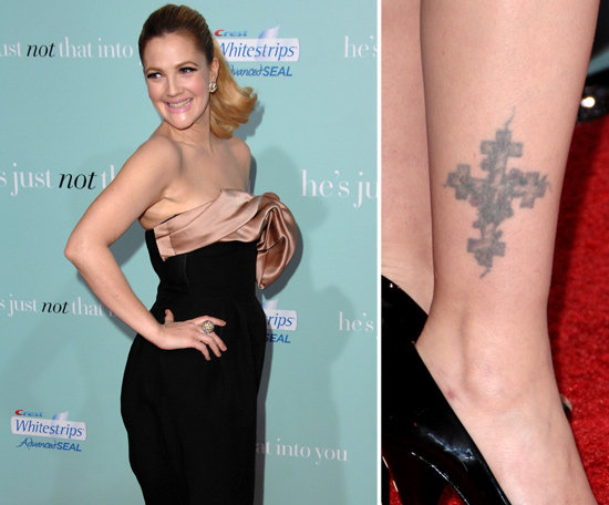 Drew Barrymore has a large cross covered in vines on her right ankle.