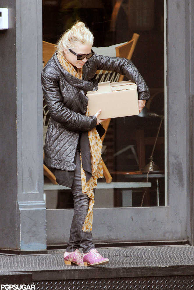 Mary-Kate Olsen carried a box out of a store while shopping in NYC.