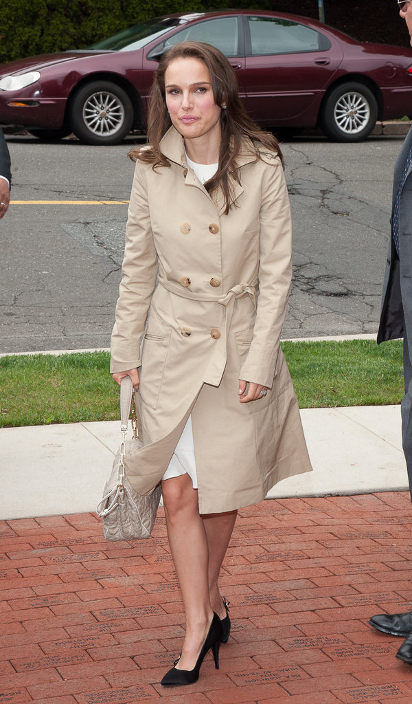 Natalie Portman covered her white dress in a trench at the Audrey Hepburn Children's House.