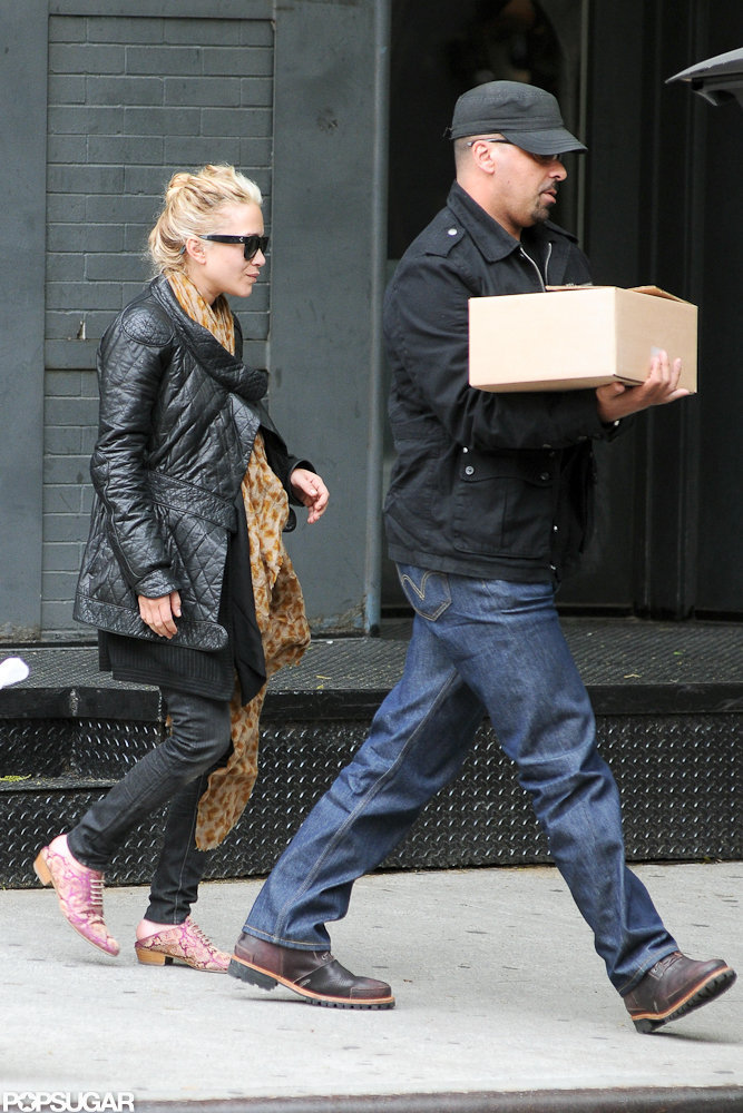 Mary-Kate Olsen wore a printed scarf and pink shoes while shopping around NYC.