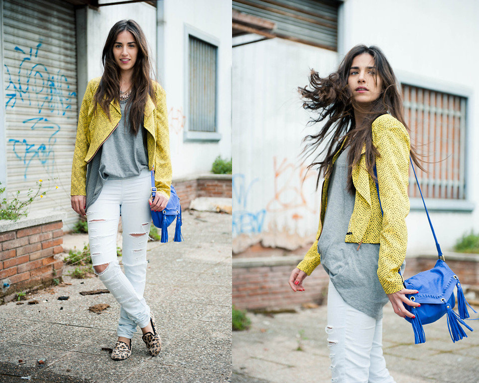 When in doubt, add cool color combos and a pop of print to your off-duty attire. We're loving this style setter's blue tasseled bag and deconstructed yellow jacket as a bright offset to ripped jeans and an oversize t-shirt. Photo courtesy of Lookbook.nu
