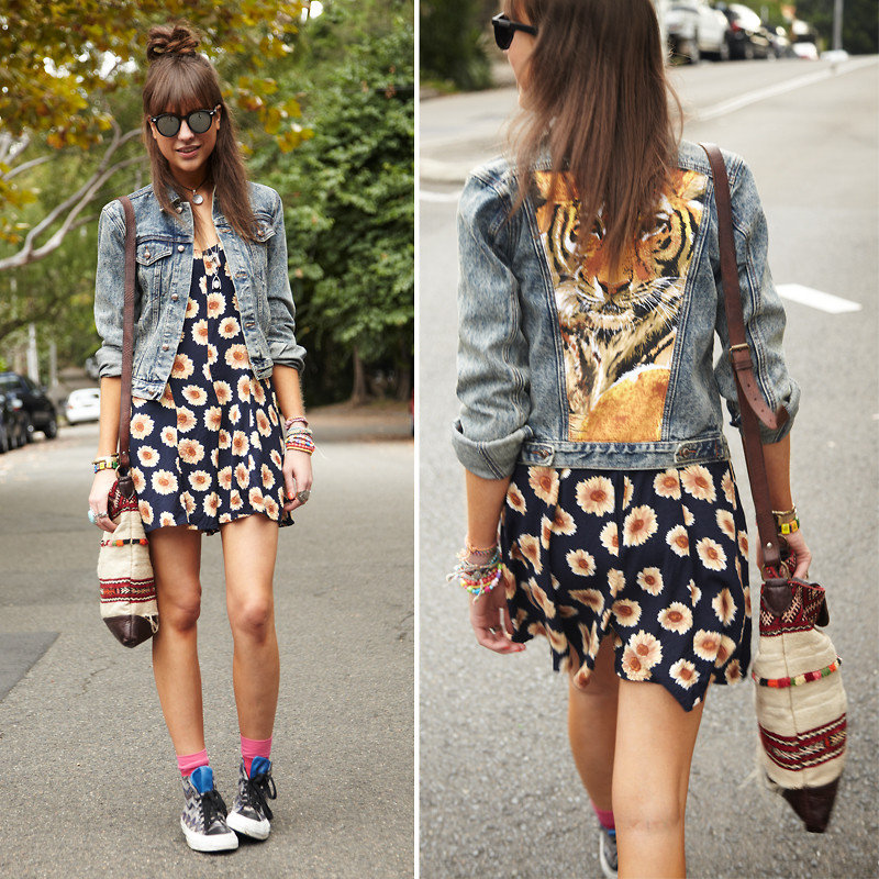 We're totally feeling this Blossom-meets-mixed-print ensemble, but the key styling pieces here are the round sunglasses, daisy-infused dress, and Missoni x Converse kicks. Photo courtesy of Lookbook.nu