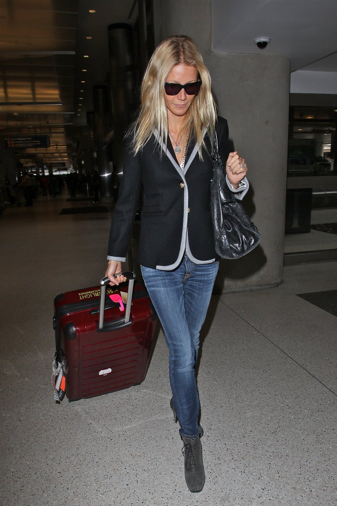Gwyneth Paltrow rocked a perfect travel style in a preppy blazer and Proenza Schouler booties.