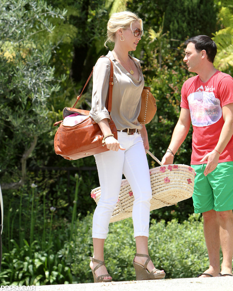 Katherine Heigl carried a large brown diaper bag to a friend's house LA.