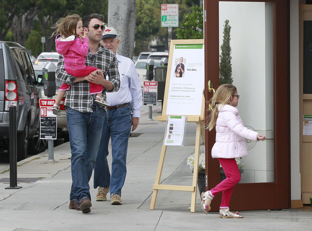 Violet Affleck led the way into a store with dad Ben Affleck and little sister Seraphina Affleck following behind during a shopping trip in LA.