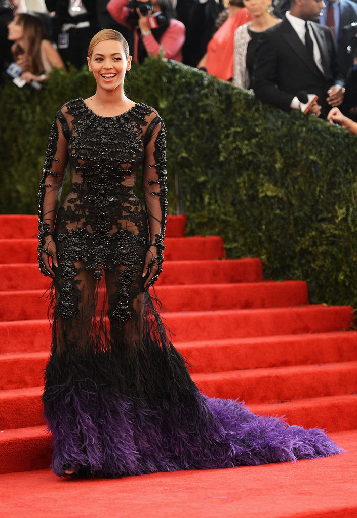 Beyoncé Knowles laughed on the stairs at the Met Gala.