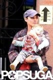 Marion Cotillard held her son Marcel while taking a break from filming in NYC.