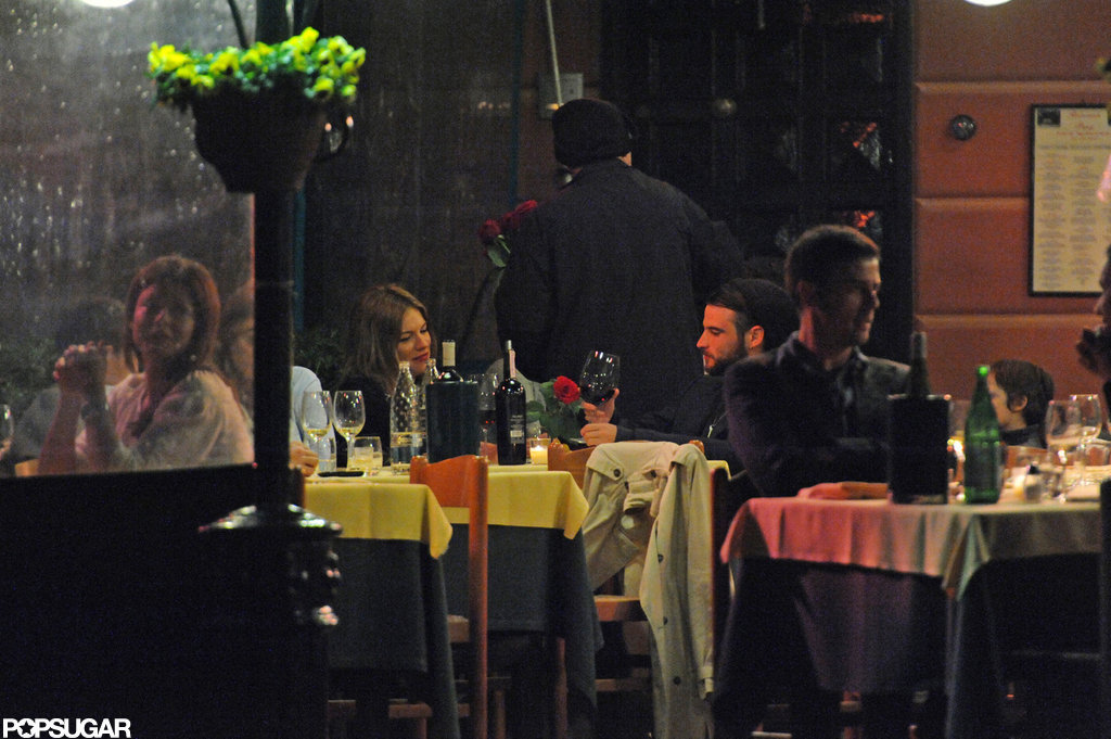 Sienna Miller and Tom Sturridge had a romantic dinner date at an outdoor cafe in Italy.