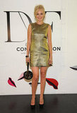Malin Akerman opted for a gilded minidress and completed the look with a DVF satchel in hand.