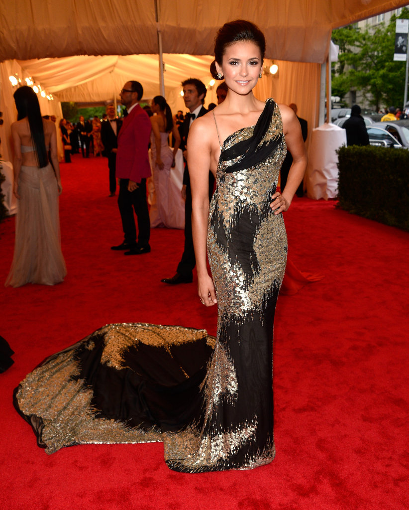 Nina Dobrev's metallic Donna Karan Atelier dress.