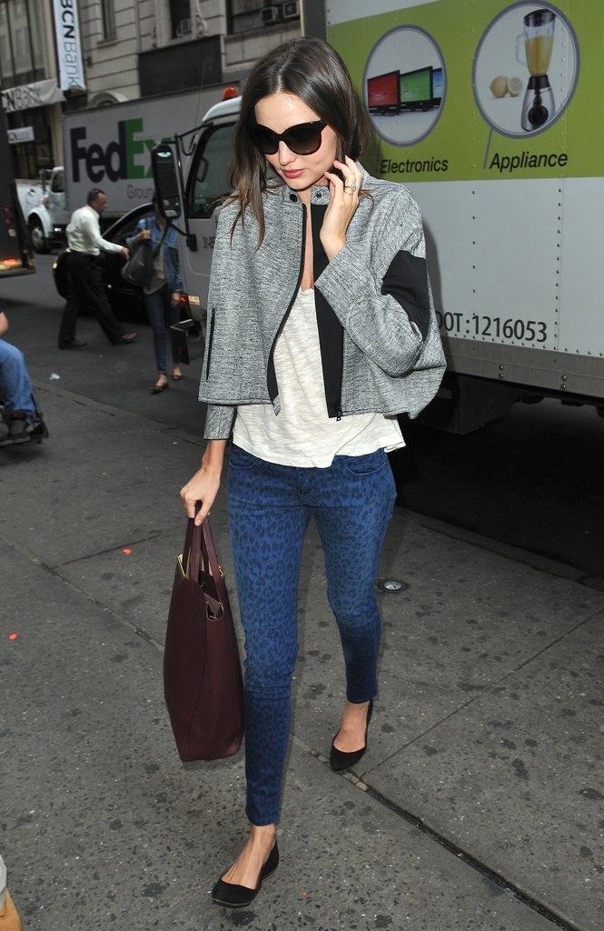 Miranda Kerr took a walk on the wild side in Current/Elliott's blue leopard-print jeans and a cropped moto-inspired Dries Van Noten jacket.