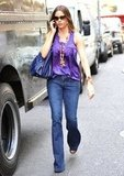 Sofia Vergara complemented her '70s-style denim with a silky purple top and a fun beaded necklace.