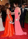 Eva Mendes and Emily Blunt brought their bright gowns together for a red-carpet chat.