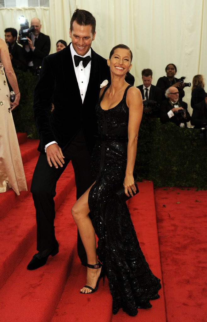 Gisele Bundchen showed some leg with husband Tom Brady on the red carpet of the Met Gala.