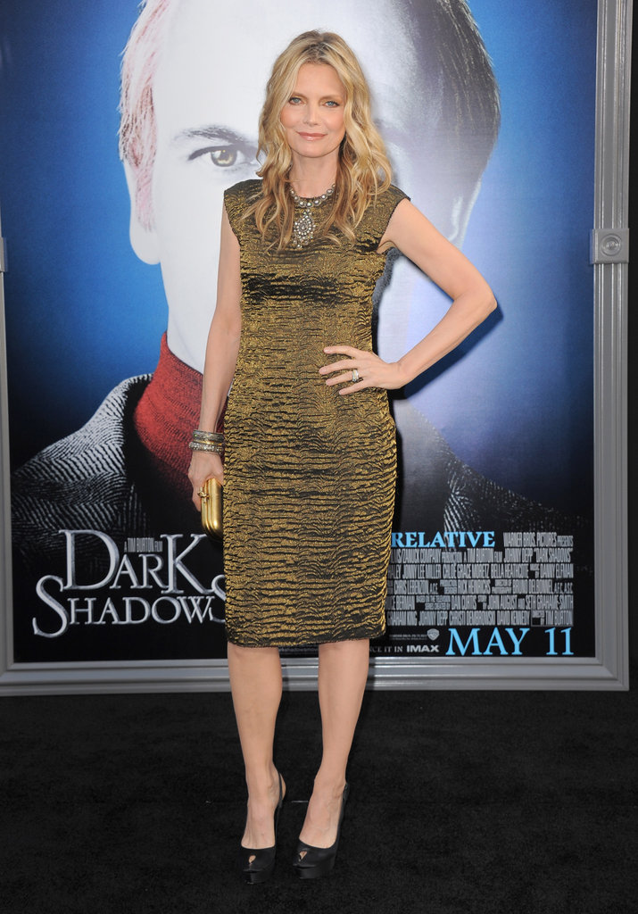 Michelle Pfeiffer posed on the black carpet in a tight-fitting dress for the Dark Shadows premiere in LA.