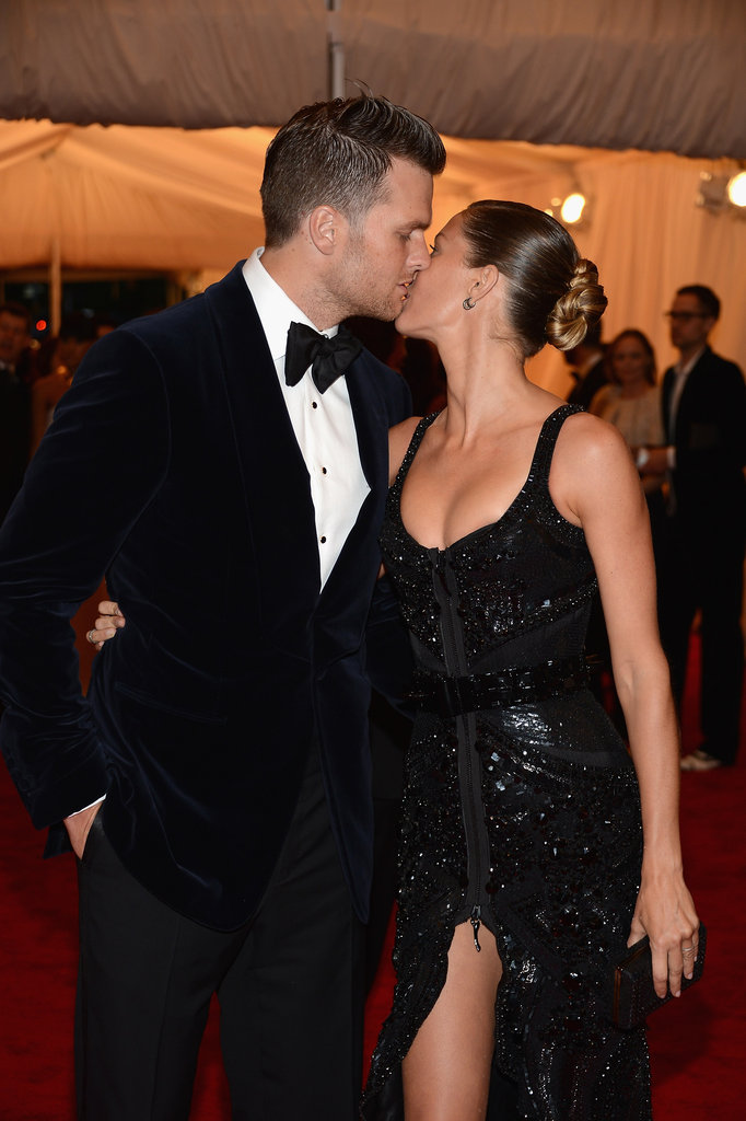 Gisele Bundchen shared a kiss with husband Tom Brady on the red carpet of the Met Gala.