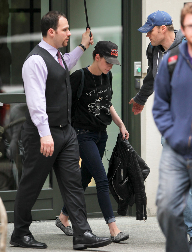 Kristen Stewart carried her leather jacket.