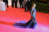 Beyoncé Knowles made a grand entrance at the Met Gala in a Givenchy gown with a feathered train.