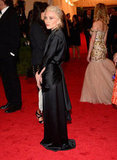 Mary-Kate Olsen posed in The Row, with a Dolce & Gabbana-clad Scarlett Johansson in the background.